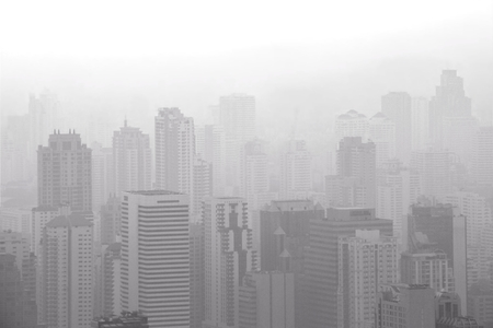 Photo for Aerial view of big city with air pollution / smog causing low visibility in the morning. Bangkok,Thailand - Royalty Free Image