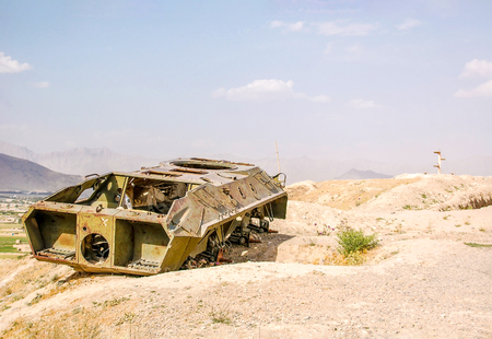 Foto de An old military vehicle in the capital of Afghanistan Kabul seen from the hillsides - Imagen libre de derechos