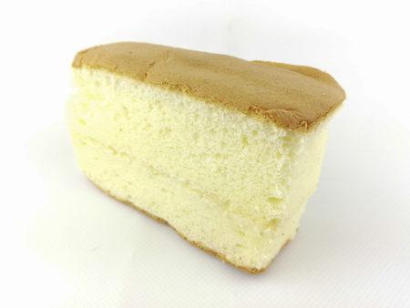 Photo for slice fresh baked chiffon cake on white background - Royalty Free Image