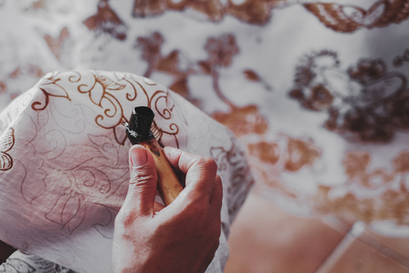 Photo for Painting watercolor on the fabric to make Batik Batik-making is part of Indonesian culture - Royalty Free Image