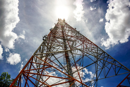 Photo for Blue sky on the background The cell phone tower is used to send phone signals. - Royalty Free Image