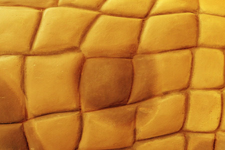 Foto de Golden stone wall construction background - Imagen libre de derechos