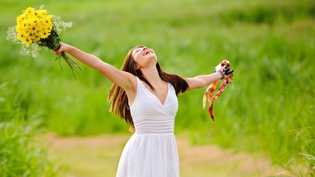Photo for Carefree girl is happy in field with flowers - Royalty Free Image