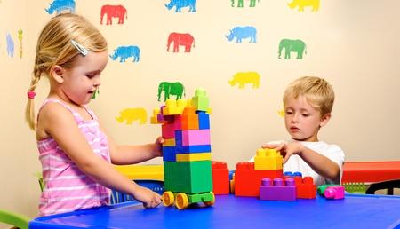 preschool children have fun with building blocks
