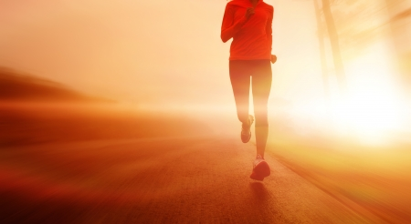 Foto de Athlete running on the road in morning sunrise training for marathon and fitness  Healthy active lifestyle latino woman exercising outdoors   - Imagen libre de derechos