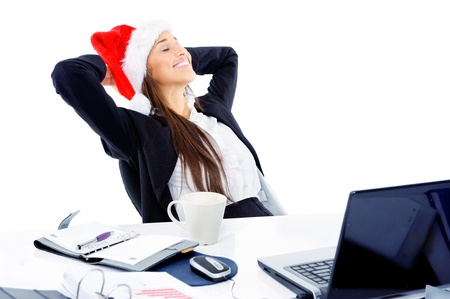 Foto de Christmas business woman daydreaming at her desk isolated on white background - Imagen libre de derechos