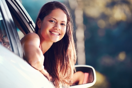 Photo pour carefree woman driving car on vacation happy smile holiday - image libre de droit