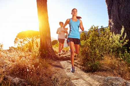 Photo pour Trail running marathon athlete outdoors sunrise couple training for fitness and healthy lifestyle - image libre de droit