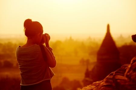 Foto de female traveller photographing temples at Bagan Myanmar Asia at sunrise - Imagen libre de derechos