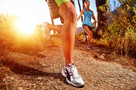 Foto de Trail running marathon athlete outdoors sunrise couple training for fitness and healthy lifestyle - Imagen libre de derechos