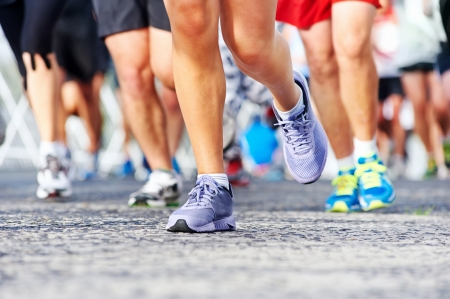 Photo pour Marathon running race people competing in fitness and healthy active lifestyle feet on road - image libre de droit