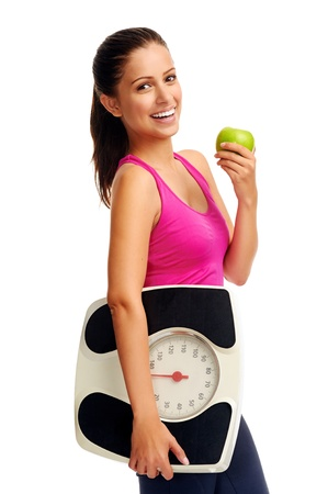 Foto de healthy diet eating woman with scale and apple for weightloss - Imagen libre de derechos