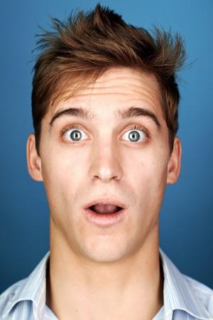 Photo pour Funny face man portrait real silly fun expression - image libre de droit