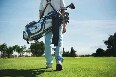 Photo for Golf man walking with shoulder bag on course in fairway - Royalty Free Image