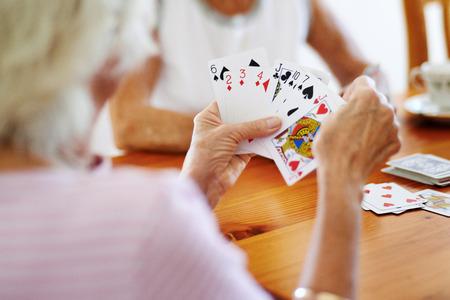Photo pour Close up shot of two elderly friends playing a card game - image libre de droit