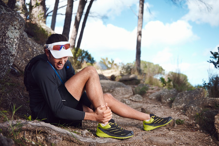 Photo pour running injury for trail runner on mountain twisted ankle - image libre de droit