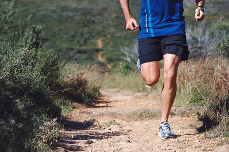 Photo for Trail running man exercising outdoors for fitness - Royalty Free Image