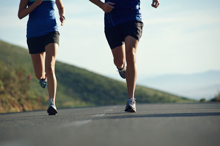 Foto per fitness exercising couple training for marathon running lifestyle - Immagine Royalty Free