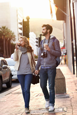 Photo for tourist couple travel with coffee ab camera walk through city having fun - Royalty Free Image