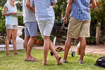 Photo pour friends outdoors at garden barbecue party gathering - image libre de droit