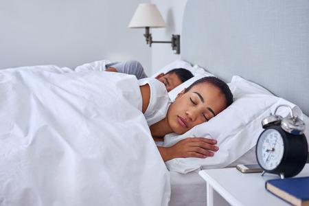 Foto de peaceful young couple sleeping comfortably in bed at home - Imagen libre de derechos