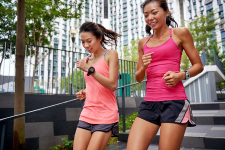 Photo for asian chinese sporty women running down stairs outdoors for morning workout - Royalty Free Image