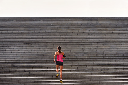 Photo pour sporty woman working out running up stairs outdoors for morning workout - image libre de droit