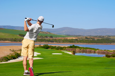 Foto de golfer hitting golf shot with club on summer vacation - Imagen libre de derechos