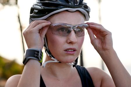 Photo pour young female wearing protective cycling glasses - image libre de droit
