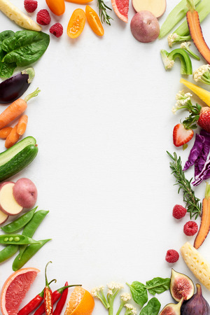 Photo for Food background border frame flatlay overhead of colorful fresh produce raw vegetables, carrot chilli cucumber purple cabbage spinach rosemary herb, plenty of copy-space in middle - Royalty Free Image