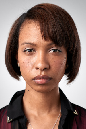 Photo for Portrait of real black african woman with no expression ID or passport photo full collection of diverse face and expressions - Royalty Free Image