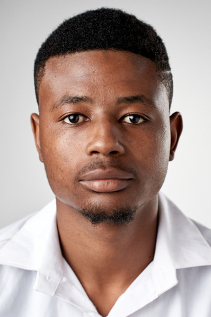 Photo pour Portrait of real black african man with no expression ID or passport photo full collection of diverse face and expressions - image libre de droit