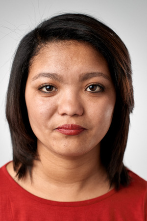 Photo pour Portrait of real chinese asian woman with no expression ID or passport photo full collection of diverse face and expressions - image libre de droit