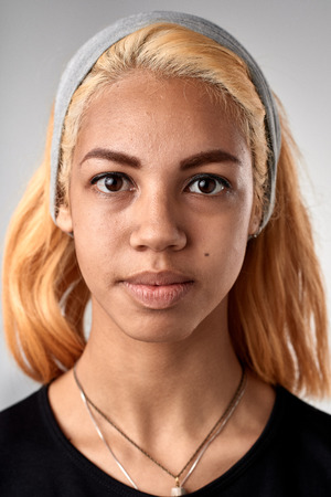 Photo pour Portrait of real black african woman with no expression ID or passport photo full collection of diverse face and expressions - image libre de droit