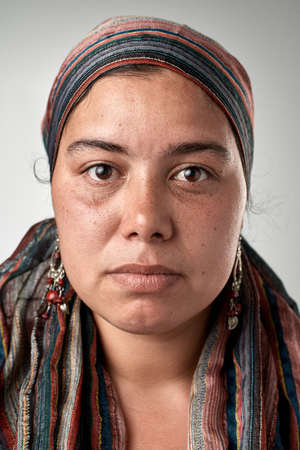 Photo pour Portrait of real gypsy woman with no expression ID or passport photo full collection of diverse face and expressions - image libre de droit