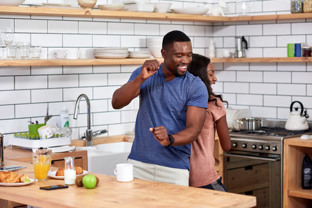 Photo for Happy african black couple having fun dancing in modern kitchen - Royalty Free Image
