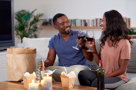 Foto de Couple enjoying food delivered by takeout app modern dining in and romantic date night - Imagen libre de derechos