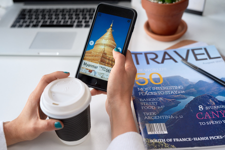 Foto de Woman browsing holiday deals destination vacation ideas on travel app application on mobile cell phone - Imagen libre de derechos