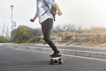 Photo pour modern commute on electric skateboard in city urban transportation battery powered vehicle - image libre de droit