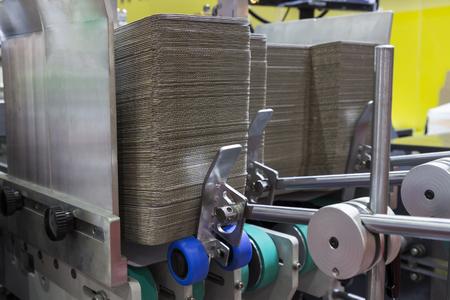 Foto de detail of a folder gluer machine for carton box - Imagen libre de derechos
