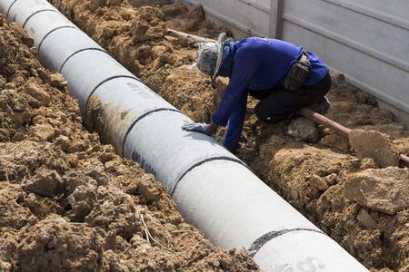 Foto für Worker install Precast concrete manholes ; for draining storm water.   - Lizenzfreies Bild