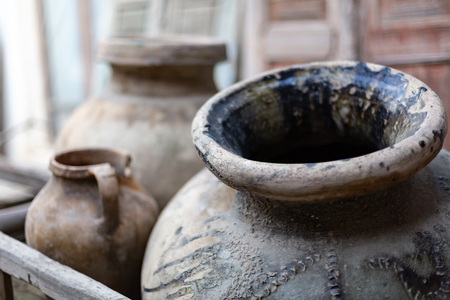 Photo pour two old ceramic dishes for water and oil made from dark clay - image libre de droit