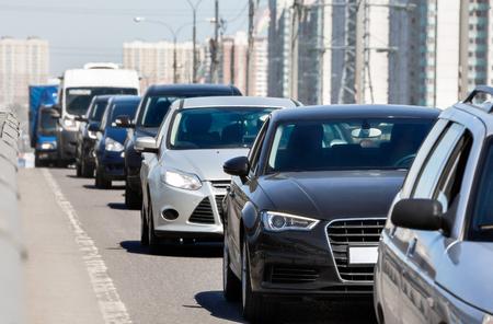 Foto de Generic cars standing in a queue during traffic jam - Imagen libre de derechos