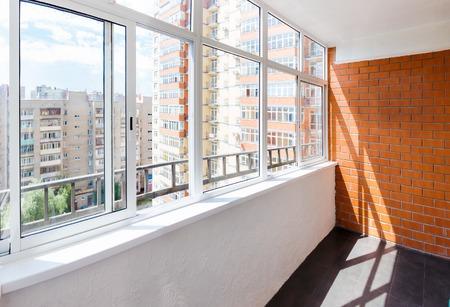 Photo for Glazed balcony with brick wall - Royalty Free Image