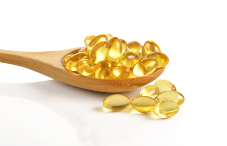 Photo pour Cod liver oil omega 3 gel capsules isolated on white background - image libre de droit