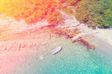 Foto de Blue boat near the pier in the sunlight - Imagen libre de derechos