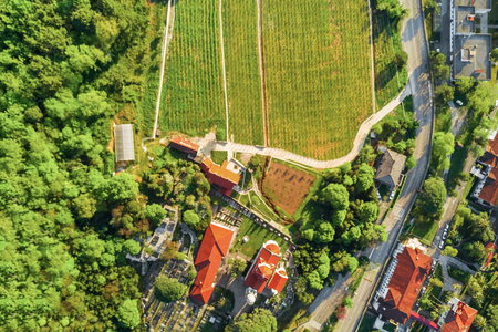 Foto de View from above to monastery building with vineyard - Imagen libre de derechos