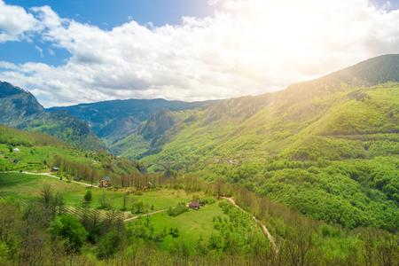 Foto de Buildings and bridge in the mountains in the sunlight, top view - Imagen libre de derechos