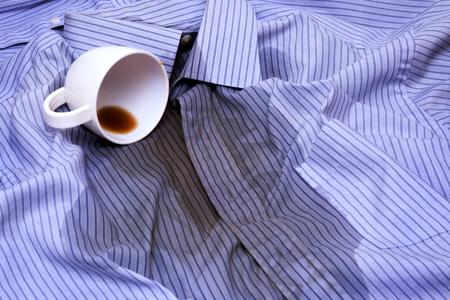 Foto de Close up photo of Coffee Spilled On A Shirt - Imagen libre de derechos