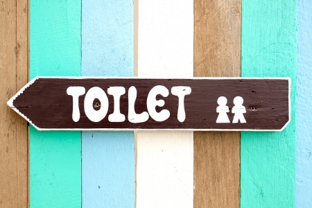 Photo for Toilet signs on the old wood wall background - Royalty Free Image